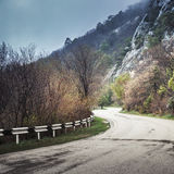 Turning mountain road in foggy day, square photo Stock Photography