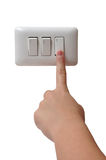 Turning Off. Young Woman Turning Off Light Switch stock photos