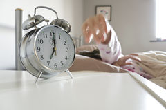 Turning Off Alarm Clock Royalty Free Stock Images