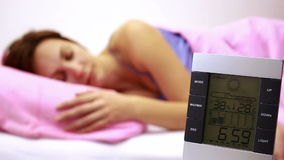 Turning off alarm clock Stock Photography