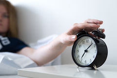 Turning off alarm clock Royalty Free Stock Photos