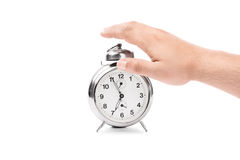 Turning off the alarm. Close-up shot of a male hand turning off the alarm clock Stock Photos