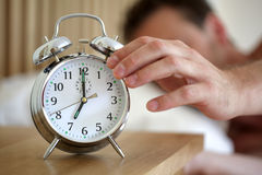 Turning Off An Alarm Clock Stock Photo