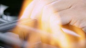 Turning off the gas cooker. Close up shots of kitchen activities while turning on and off fire on gas cooker cooktop stock footage