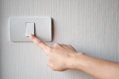 Turning on or off on light switch Stock Photo