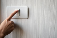 Turning on or off on light switch Stock Images