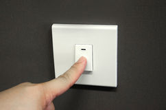 Turning off light switch Stock Photo