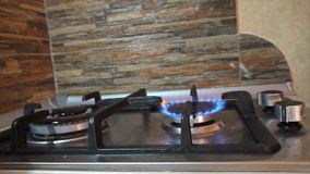 Turning On and Off a Stove Burner. In the kitchen. Close-up shot stock video