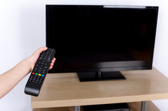 Turning off the TV Stock Images