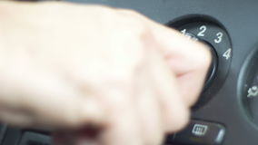 Turning Off the Ventilator. Man is tuning off the button inside vehicle cabin stock footage