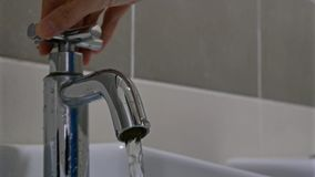 Turning off the water tap. Women hand turning off the water tap stock video footage