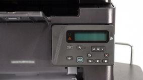 Turning on office printer. Starting and warming up office printer stock footage