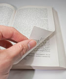 Turning the page. Close up shot of someone turning a book page Royalty Free Stock Photos