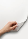 Turning the page. Close up of female hand turning the blank page with copy space Royalty Free Stock Images