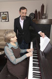 Turning the page for piano player Stock Images