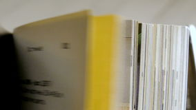 Turning pages of a magazine. Close up. Turning pages of a magazine stock footage