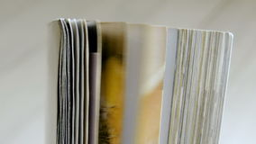 Turning pages of a magazine. Close up. Turning pages of a magazine stock video