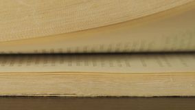 Turning the pages of a old book. Close up stock footage