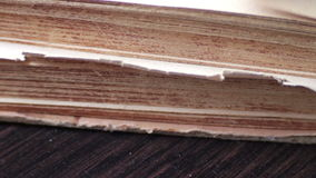 Turning the pages of an old book close-up. Pages faded old yellow book close up view.Turning the pages of an old book close-up stock video footage