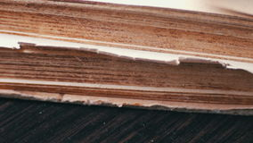 Turning the pages of an old book close-up stock video footage