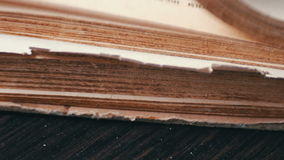 Turning the pages of an old book close-up stock video