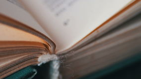 Turning the pages of an old book close-up. Book pages turning,Scrolling a Book in Macro stock video