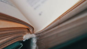 Turning the pages of an old book close-up. Book pages turning,Scrolling a Book in Macro stock footage