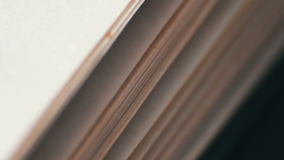 Turning the pages of an old book close-up. Book pages turning,Scrolling a Book in Macro stock video footage