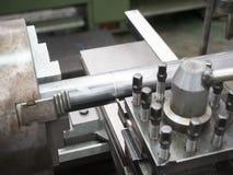 Turning part by manual lathe machine Stock Photos