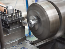 Turning part by manual lathe machine Royalty Free Stock Images