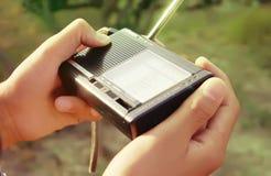 Turning on the Portable radio Stock Photo