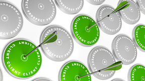 Turning prospect to client. Green targets with client marking, green arrows hitting the center and grey targets with prospect marking Stock Images