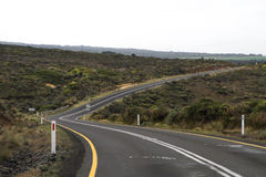 A turning road. A turning asphalt road in the countryside Royalty Free Stock Photos