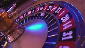 Turning Roulette Wheel in a casino - perspective view stock video
