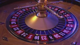 Turning Roulette Wheel in a casino stock video