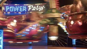 The turning roundabout at night in an amusement park. Amusement park at night. Flashing lights stock video
