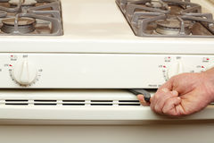 Turning on Self Cleaning Stove Stock Images