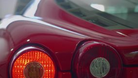 Turning signals of red sport car blink. Close up view. Turning signals of red sport car blink stock video