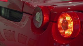 Turning signals of red sport car blink. Close up view. Turning signals of red sport car blink stock video footage