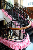The turning staircase with iron railings. In a luxury hotel Stock Image