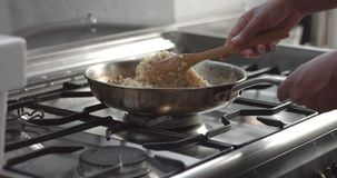 Cooking leeks and parmesan risotto video stock video footage