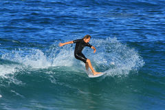Turning Surfer in Southport, Australia. Young Surfer in Southport Gold Coast, Queensland Australia Stock Image