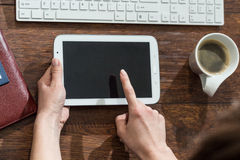 Turning on tablet Royalty Free Stock Image