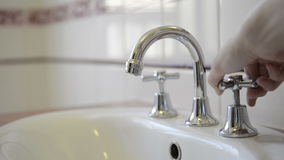 Turning On Taps Stock Images