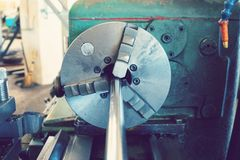 Turning threaded parts on the machine for use in mechanical engineering. Turning threaded parts on the machine for use in mechanical engineering royalty free stock images