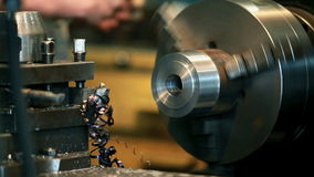 Turning to metal. Process of metal cutting on a lathe  tripod Close to stock video footage