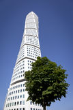Turning Torso. The Turning Torso in Malmoe with a tree in the front Stock Photos
