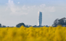 Turning torso Malmö from the rapeseed fields. Turning Torso in Malmö photo taken from 7 miles from the rapeseed fields in the foreground Stock Image
