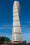 Turning Torso in Malmo, Sweden. Malmo, Sweden - August 04, 2010: The twisted skyscraper Turning Torso seen from below on a sunny and warm summer day in Malmo Royalty Free Stock Images