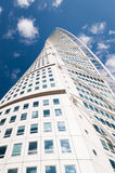 Turning Torso in Malmo, Sweden. Turning Torso, the highest building in south Sweden (Scania), in a sunny summer day, seen in the mirror of another building Royalty Free Stock Photo